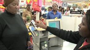 Flickr Photo: A SASSA grant recipient using her new SASSA Debit MasterCard card at point of sale to pay for her groceries