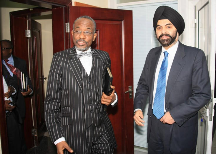 Ajay Banga, MasterCard Worldwide President and CEO, right, and Sanusi Lamido Sanusi, Governor of the Central Bank of Nigeria, discuss the milestones achieved by Nigeria&#039;s cashless initiative in Abuja, Nigeria, on Monday Jan. 14, 2013. Banga said the Central Bank of Nigeria&#039;s Cashless Policy, and the solutions created to achieve its goals, is viewed with global interest as a benchmark in driving financial inclusion in emerging markets. Driven by local government, the modernization of the Nigerian payments industry will positively impact economic growth in Nigeria by helping to eliminate inefficiency, corruption and fraud, which are issues faced by all cash-dependent economies.